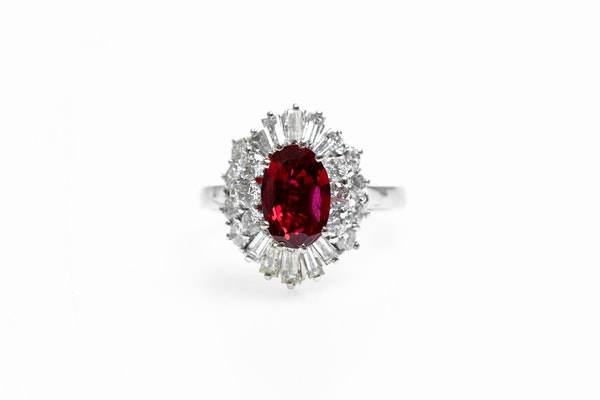 A very fine 18 Carat White Gold (tested) Oval Natural Untreated Siam Ruby (1.71 Carats) and Diamond Cluster Ring, Circa 1970 - image 1
