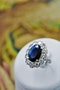 A remarkable Oval Sapphire & Diamond Cluster Ring mounted in Platinum, French, Circa 1935 - image 1