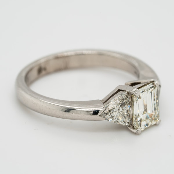 Emerald cut diamond ring with triangular cut diamond shoulders - image 2