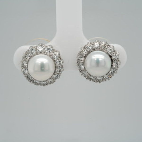 Cultured pearl and diamond earrings mounted in platinum - image 2