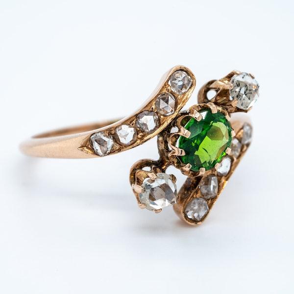 Demantoid green garnet and  diamond crossover ring. - image 2