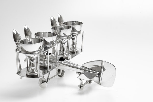 Fabulous Silver Plated Novelty Egg Cup holder in the shape of a biplane - image 4