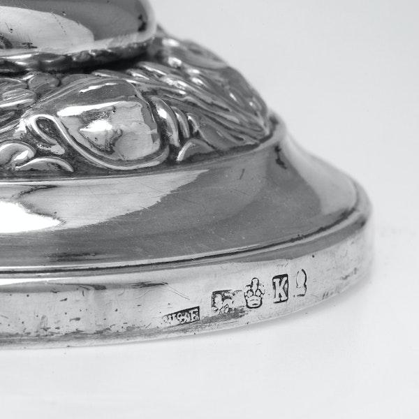 A pair of Georgian silver candlesticks - image 2