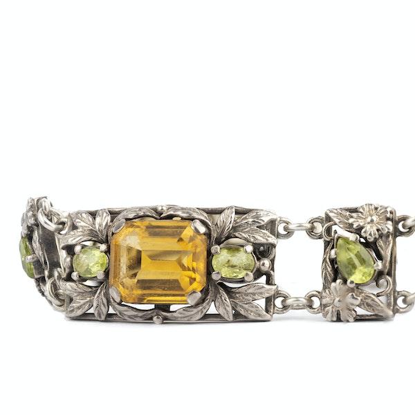 A Silver, Citrine and Peridot bracelet by Bernard Instone - image 2