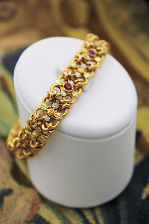 A very fine 18 Carat Green, Yellow and Pink Gold (French marked) Ruby set bracelet, French, Circa 1935 - image 1