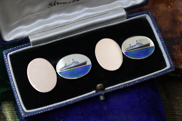 An extremely fine pair of oval 9ct Yellow Gold Enamel Cufflinks celebrating the Queen Elizabeth 1938 - 1966 (Cunard), English, Circa 1969 - image 1