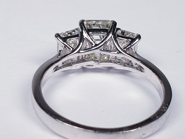Emerald cut diamond and baguette three stone ring  DBGEMS - image 1