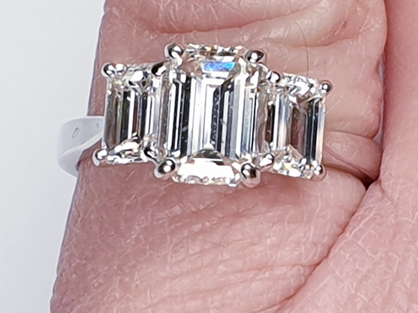 Emerald cut diamond and baguette three stone ring  DBGEMS - image 3