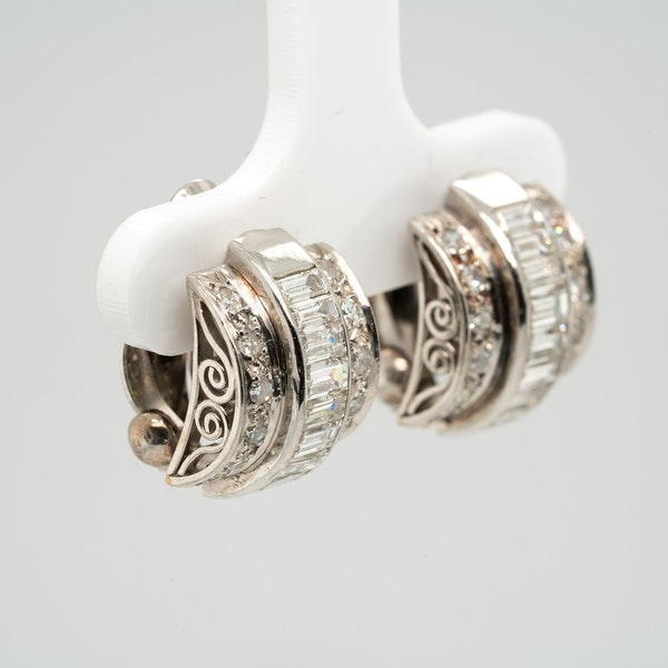 A pretty pair of platinum mounted baguette and brilliant cut diamond earrings - image 2