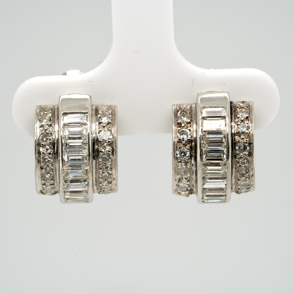 A pretty pair of platinum mounted baguette and brilliant cut diamond earrings - image 1