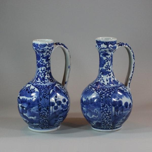 Pair of Japanese Arita blue and white ewers, c 1680 - image 1