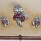 Earrings and brooch set in 18 ct white gold  with diamonds and rubies in fitted Garrards box - image 1