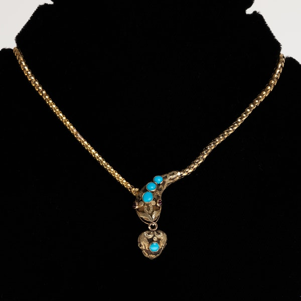 Victorian turquoise and ruby full snake necklace holding a heart - image 1