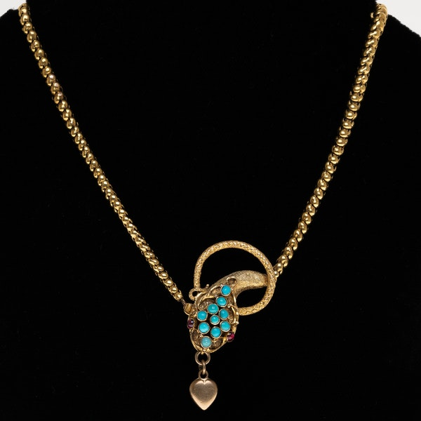 Victorian snake necklace with turquoise head and ruby eyes holding a heart - image 1