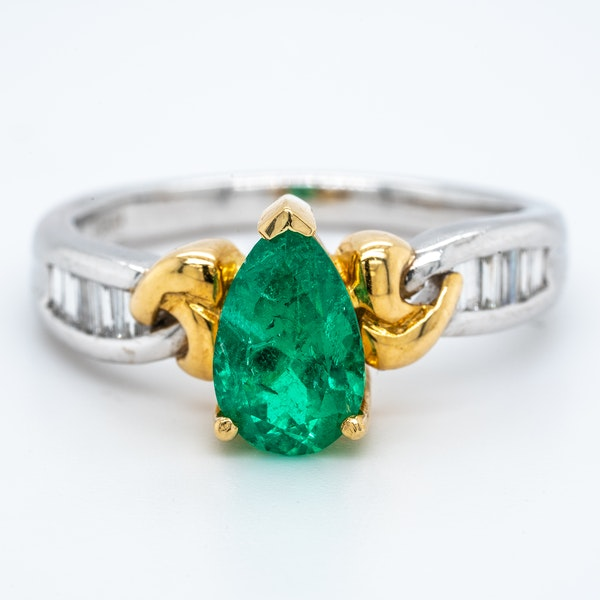 Pear shaped emerald and diamond baguette shoulders contemporary ring - image 1