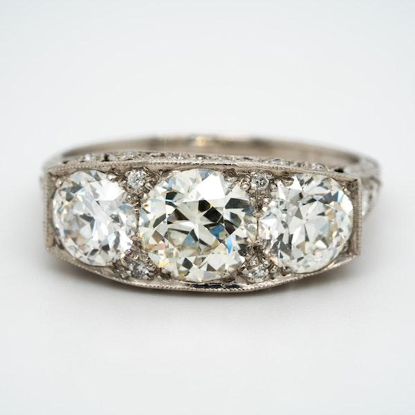 Platinum set Art Deco large 3 stone ring  with diamond studded mount - image 1