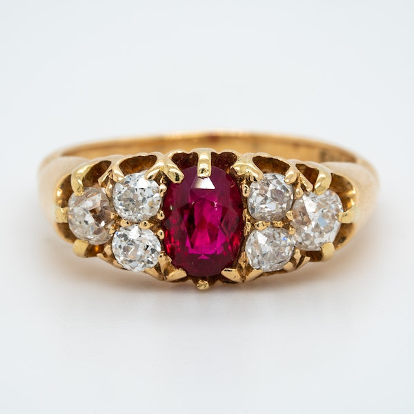 Ruby and diamond half hoop ring with trefoil shoulders - image 1