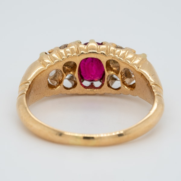 Ruby and diamond half hoop ring with trefoil shoulders - image 4