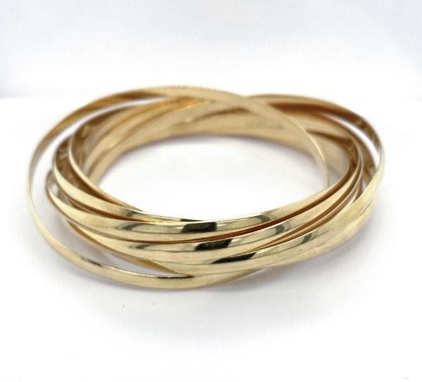 The rare 7 bangles of the trinity collection designed snd signed Cartier - image 1