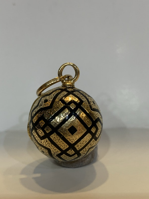 An enamel and 18 carat gold C19th orb seal that opens to reveal a gold cased green tourmaline with eye letter S engraved on the base of the stone - image 1