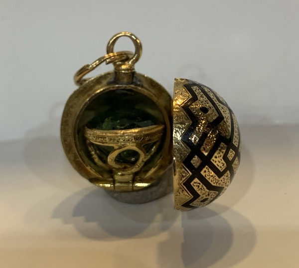 An enamel and 18 carat gold C19th orb seal that opens to reveal a gold cased green tourmaline with eye letter S engraved on the base of the stone - image 2