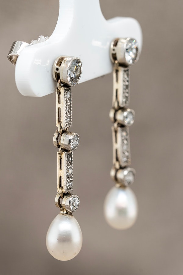 A pair of platinum ,diamond and natural pearl  Edwardian  earrings - image 2