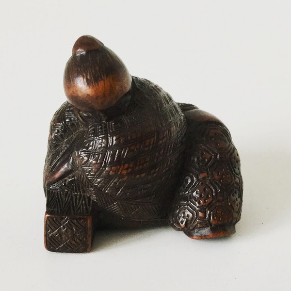 Wood netsuke of sage - image 1