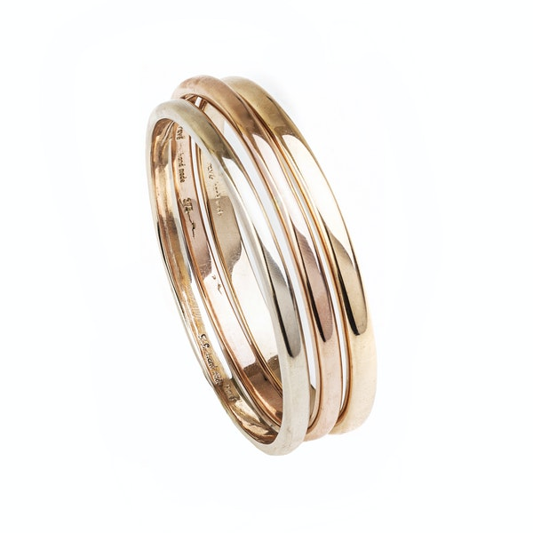 A Modern trio of Rose, Yellow, and White Gold Bangles - image 3