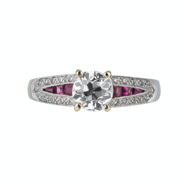 Diamond solitaire ring with diamond shoulders and ruby insets - image 1