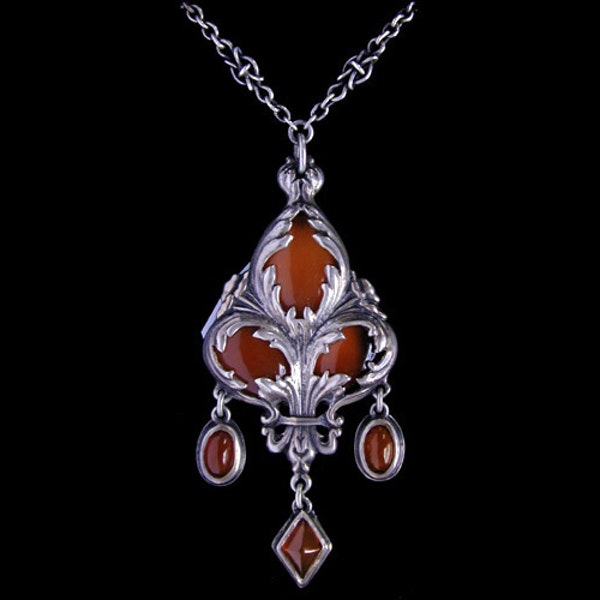 Omar Ramsden. An Arts & Crafts / Art Nouveau silver carnelian set pendant. - image 1