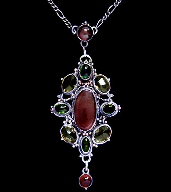 Mart Thew. An Arts & Crafts / Art Nouveau Scottish silver pendant set with carnelian, citrine and green tourmaline   . - image 1