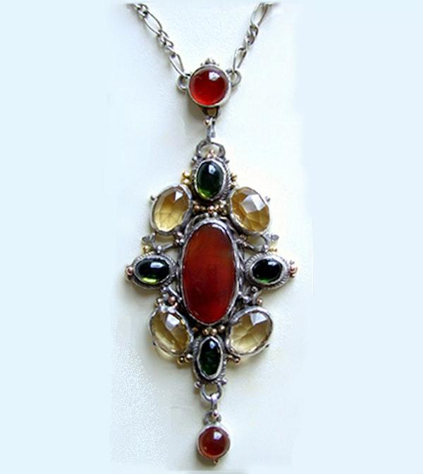 Mart Thew. An Arts & Crafts / Art Nouveau Scottish silver pendant set with carnelian, citrine and green tourmaline   . - image 2