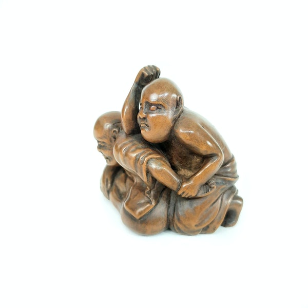 Japanese wood carving of two men - image 2