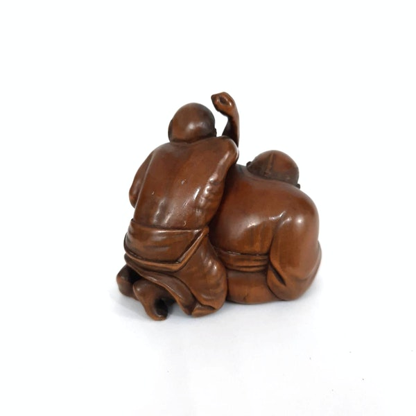 Japanese wood carving of two men - image 6