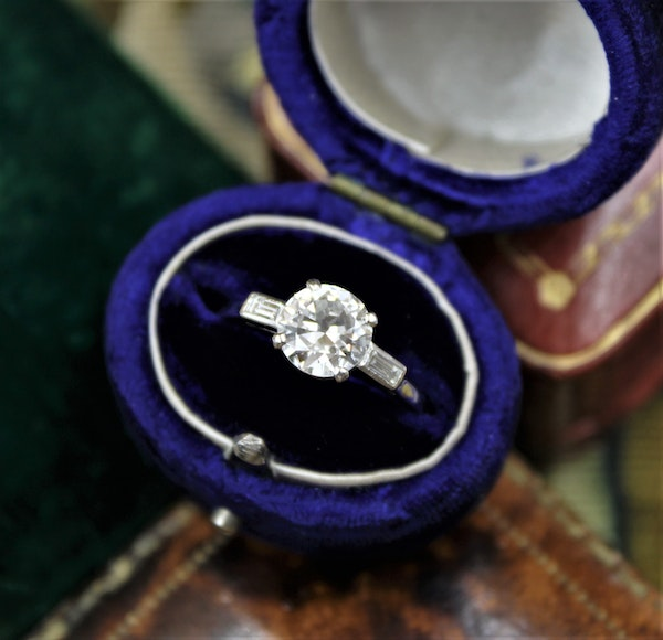 A 1.30ct Diamond Solitaire Ring to Baguette Shoulders mounted in Platinum, Circa 1950 - image 1