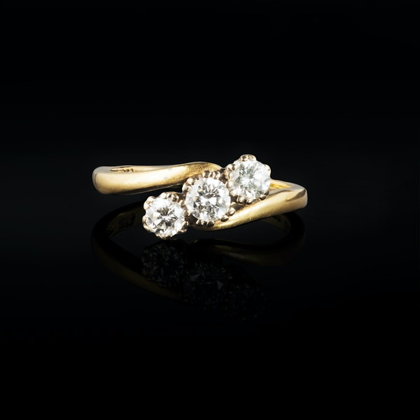 A Three stone Diamond Gold Ring - image 1
