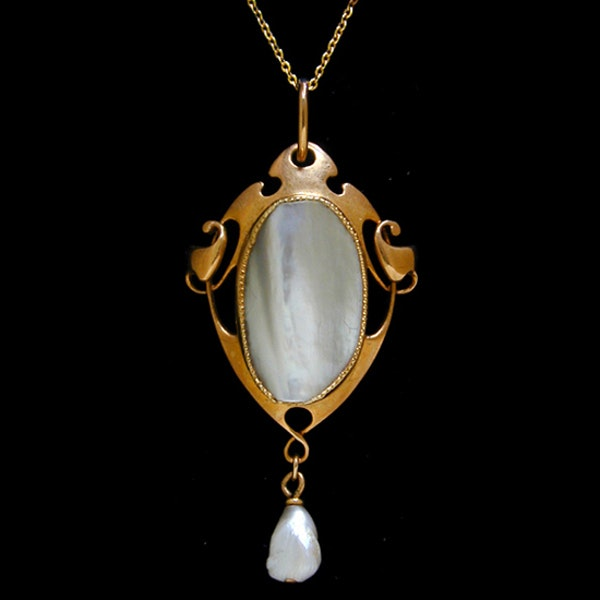 Archibald Knox for Liberty & Co. An Arts & Crafts / Art Nouveau gold pendant set mother of pearl. Circa 1900. - image 1