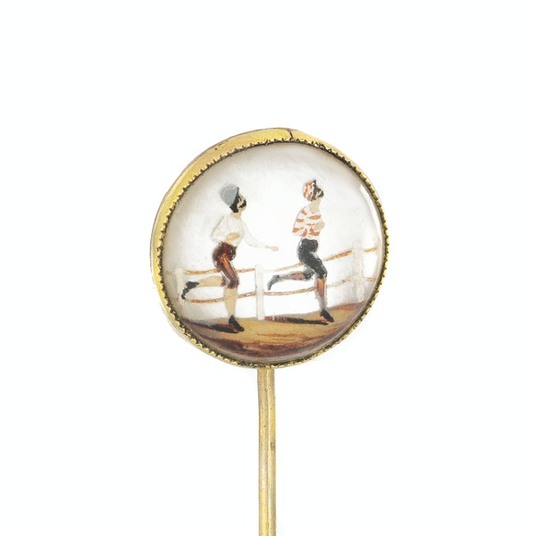 A Gold Rock Crystal Tie Pin of runners in a race - image 2