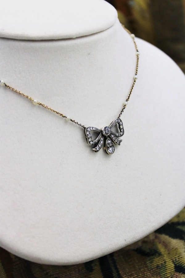 A very fine Victorian Diamond Bow Pendant mounted in Silver and High Carat Yellow Gold, English, Circa 1890 - image 1