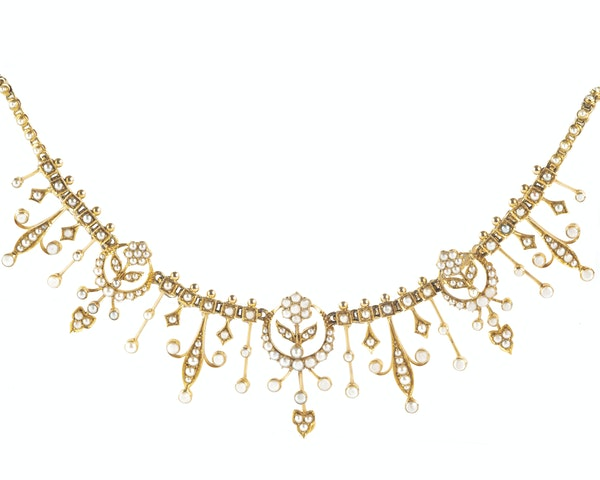 A Gold and Pearl Necklace by Goldsmiths & Silversmiths - image 1
