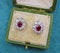A pair of Natural Ruby and Diamond Cluster Earrings in Platinum and 18ct White Gold, Circa 1950 - image 1