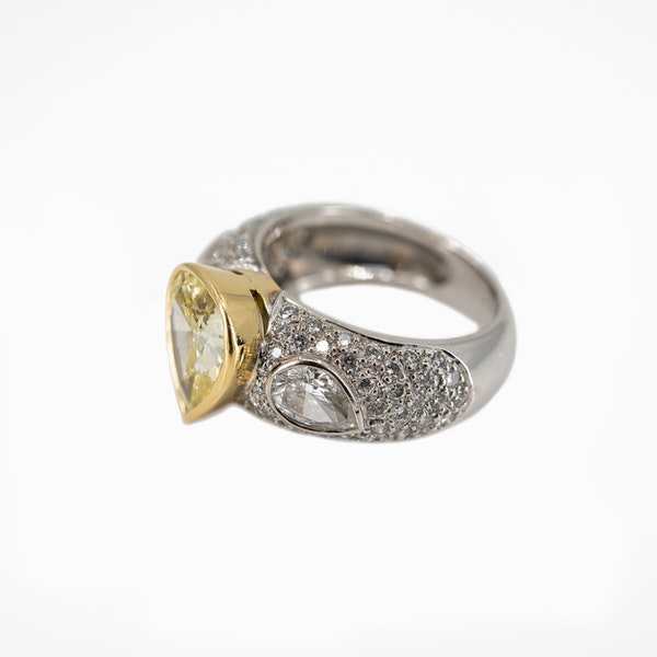 """A Dress Ring Set With A """"Fancy"""" Yellow Pear Shaped Diamond Offered By The Gilded Lily - image 3"""