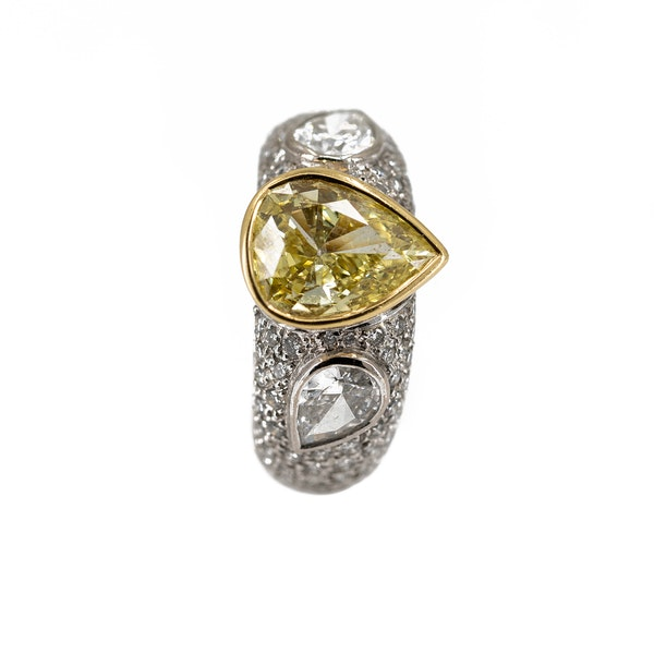 """A Dress Ring Set With A """"Fancy"""" Yellow Pear Shaped Diamond Offered By The Gilded Lily - image 4"""
