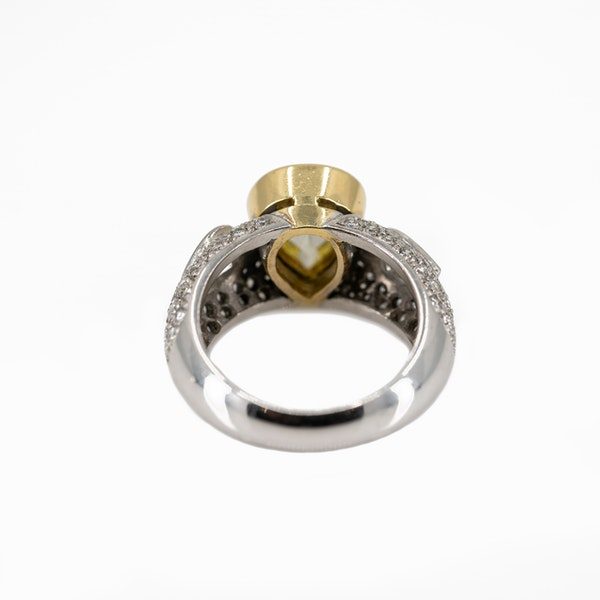 """A Dress Ring Set With A """"Fancy"""" Yellow Pear Shaped Diamond Offered By The Gilded Lily - image 5"""