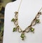 An exquisite Peridot & Seed Pearl Festoon Necklace with a matching Quatrefoil style detachable Pendant/Brooch in 15 Carat Yellow Gold, English, Circa 1900 - image 2