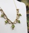 An exquisite Peridot & Seed Pearl Festoon Necklace with a matching Quatrefoil style detachable Pendant/Brooch in 15 Carat Yellow Gold, English, Circa 1900 - image 3