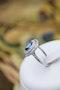 A fine Platinum Oval Ceylon Sapphire & Double Diamond Cluster Ring, Circa 1940.. - image 2
