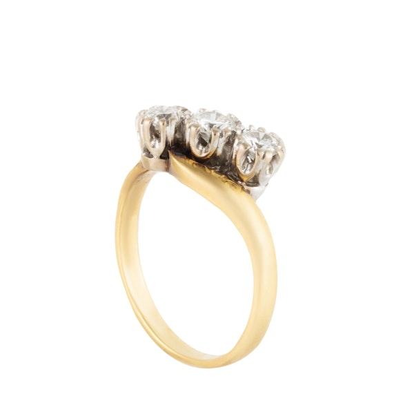 A Three Stone Diamond Gold Ring - image 4