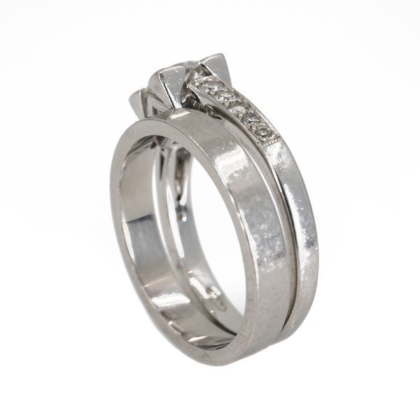 Diamond solitaire ring with diamond shoulders together with plain platinum wedding ring with a cut out for the diamond ring - image 3