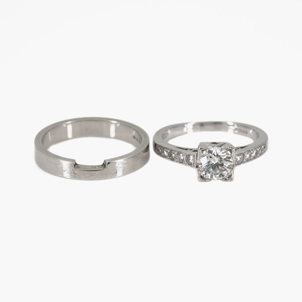 Diamond solitaire ring with diamond shoulders together with plain platinum wedding ring with a cut out for the diamond ring - image 4